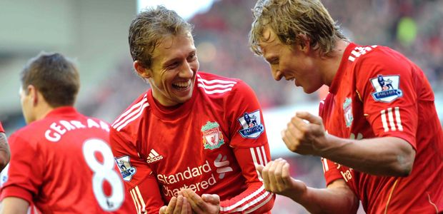 Lucas and Kuyt celebrating the birth of Lucas' son Pedro after Kuyt's goal against Sunderland